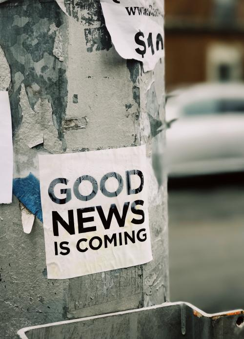 "Sticker on a Wall which reads ""Good News is coming"""